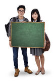 Two student holding empty blackboard Stock Image