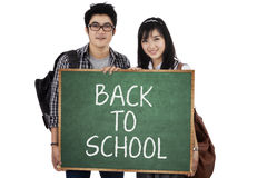 Two student holding small blackboard 1 Royalty Free Stock Photography