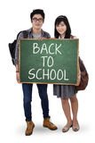 Two student holding small blackboard Stock Images