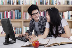 Two student laughing in class 1 Royalty Free Stock Photo