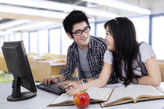 Two student laughing in class Stock Photo