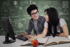 Two student laughing in class 2 Stock Photos