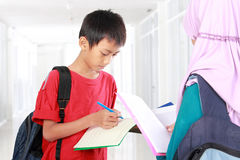 Two student studying in school Stock Photos