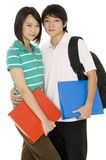 Two Students. Two asian college students with bag and files on white background stock image