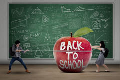 Two students back to school Stock Photo