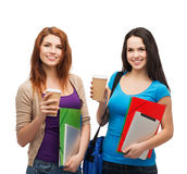 Two students with bag, folders, tablet and coffee Royalty Free Stock Photo