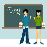 Two students with blackboard Stock Images