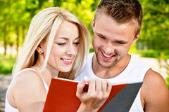 Two students with book Royalty Free Stock Image