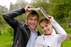 Two students with book Stock Photo