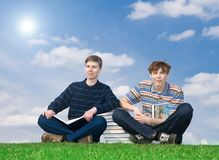 The two students with the book Royalty Free Stock Photo