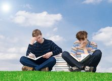 The two students with the book Stock Image