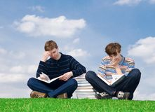 The two students with the book stock photos