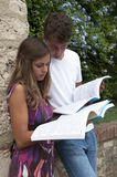 two students with book at campus Stock Photos