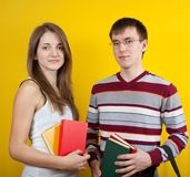 Two students with books Stock Photos