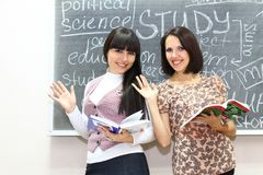 Two students with books Royalty Free Stock Photography