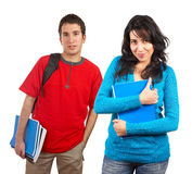 Two students with books and backpacks royalty free stock images