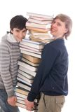 Two students with books isolated on a white Royalty Free Stock Image