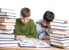 Two students with books isolated on a white Royalty Free Stock Photography