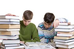 Two students with books isolated on a white Royalty Free Stock Photo