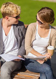 Two students with books, notebooks and folders Royalty Free Stock Photos