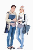 Two students with books prepared for winter Stock Image