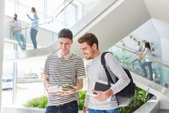 Two students with books in the uni. Study in cooperation Royalty Free Stock Image