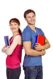 Two students both with notepads Royalty Free Stock Photo