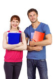 Two students both with notepads Stock Photos