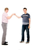 Two students bumping fists. Isolated on white background Stock Photos