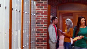 Two students chatting and walking in the hallway stock footage