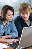 Two students cooperating Royalty Free Stock Images