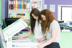 Young students at a copy center stock photography