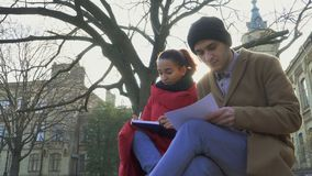 Two students discuss exams near university stock video footage