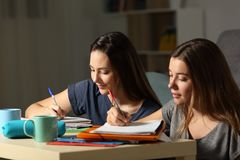 Two students doing homework together. In the night at home Royalty Free Stock Images