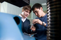 Two students are doing measurements Royalty Free Stock Photo