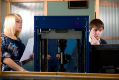 Two students in front of a monitor in practice Royalty Free Stock Photos