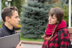 Two students talking outdoor Royalty Free Stock Images