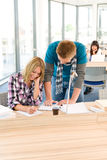 Two students at high school writing notes royalty free stock images