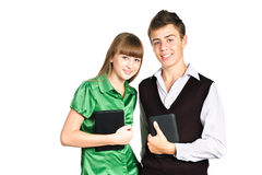 Two students holding pc tablets isolated on white Stock Photos