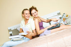 Two students at home Stock Images