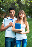 Two Students In Park With Book Outdoors Royalty Free Stock Image