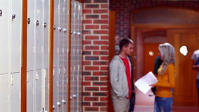 Two students laughing and walking in the hallway. At the university stock video footage
