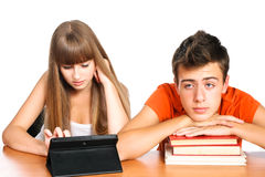 Two students learning with books and laptop. Two students learning with books and pad: concept new educational technology Stock Photography