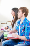 Two students learning in class Royalty Free Stock Photography