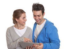 Two students learning with a tablet Royalty Free Stock Images