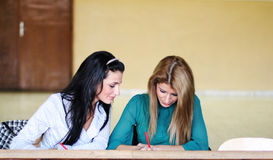 Two students learning together. In the university corridor before an exam Stock Image
