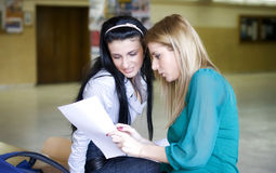 Two students learning together. In the university corridor before an exam Stock Photo
