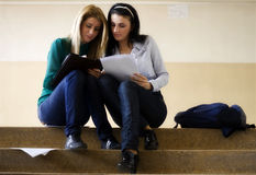 Two students learning together. In the university corridor before an exam Royalty Free Stock Image