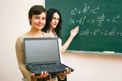 Two students at the lesson with laptop Royalty Free Stock Image