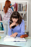 Two students in the library Stock Photography